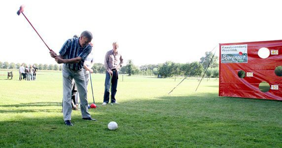 Farm golf,  playing golf between the cows    Cheese factory