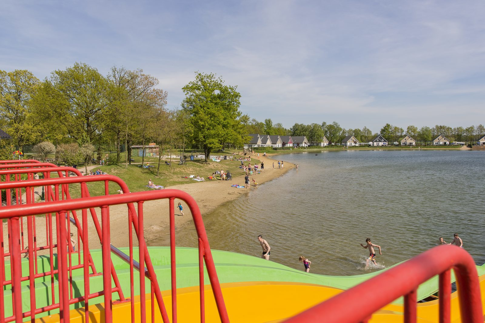 Recreational lake & beach pool with slides and view